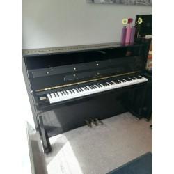 Piano d'occasion Samick SU-110 noir verni